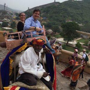 Naomi riding an elephant in India